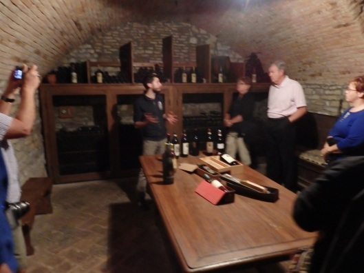 Tasting of the wine in the depths of the Castle cellar