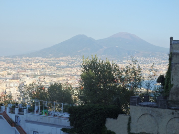 Mt. Vesuvius looms in the distance over Napoli