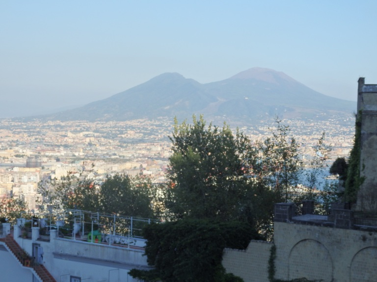 Mt. Vesuvius looms in the distance over Napoli