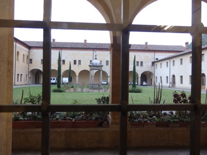 Looking at the courtyard through the shop window