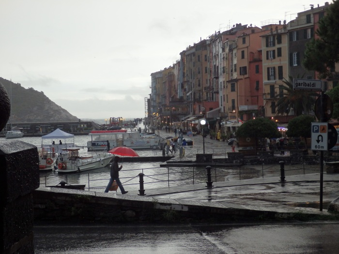Portovenere fishing harbor with stunning yachts and sailboats amidst the little boats.