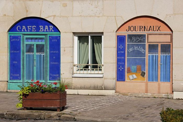 Building front with painted-on shop doors and windows