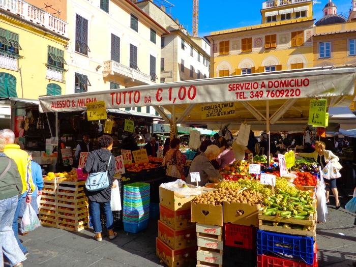 Bustling shoppers among the fruits and vegetables in Chiavari, Italy