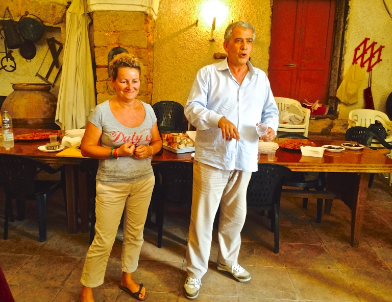 Paola with Danilo Mastracco from Slow Food Terracina enjoy a moment together in front of the dinner table. Notice the huge clay pot at the far left. These were used to store olive oil at one time.