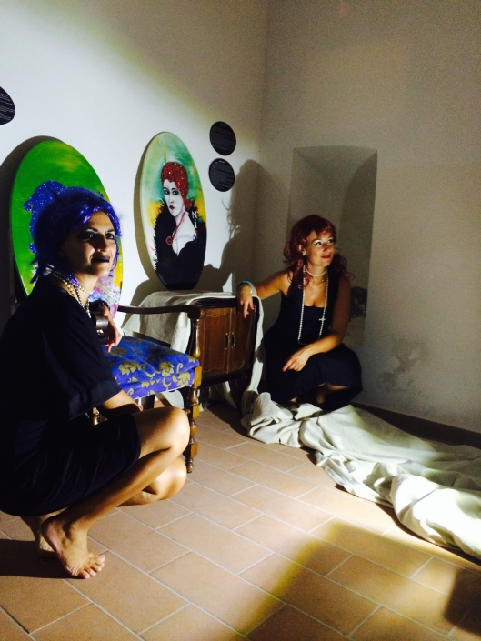 Two women who own the art gallery and display their paintings