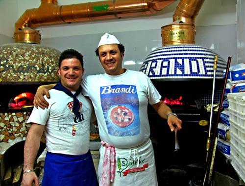 Pizza makers in Antica Pizzeria  brandi in Naples