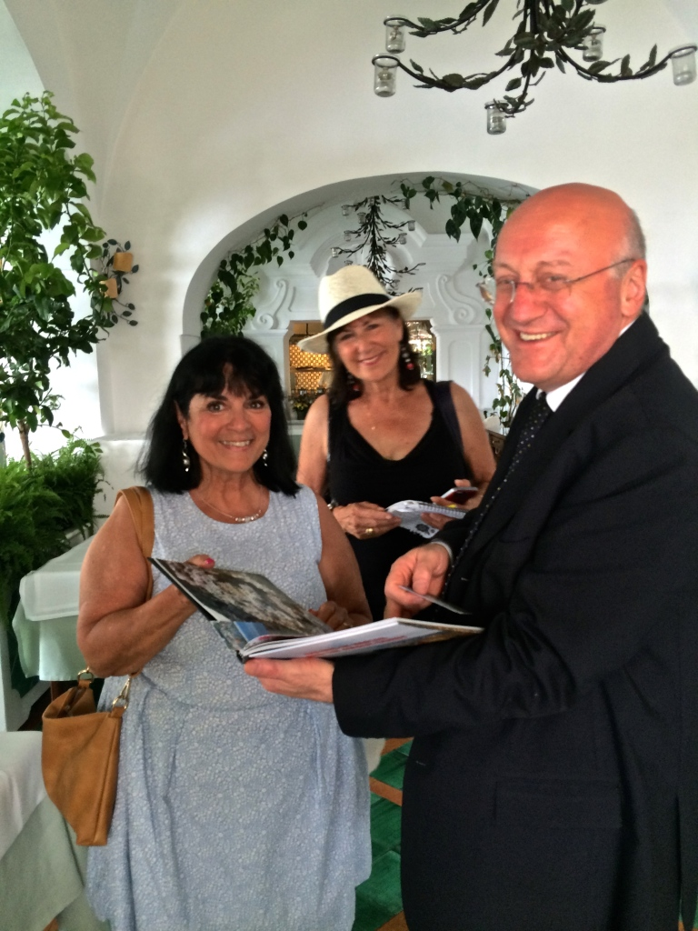 Margie Miklas presents with her book. Victoria De Maio smiles brightly in the center