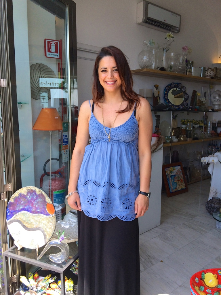 Lisa stands in front of her shop at L'arte della ceramica in Positano