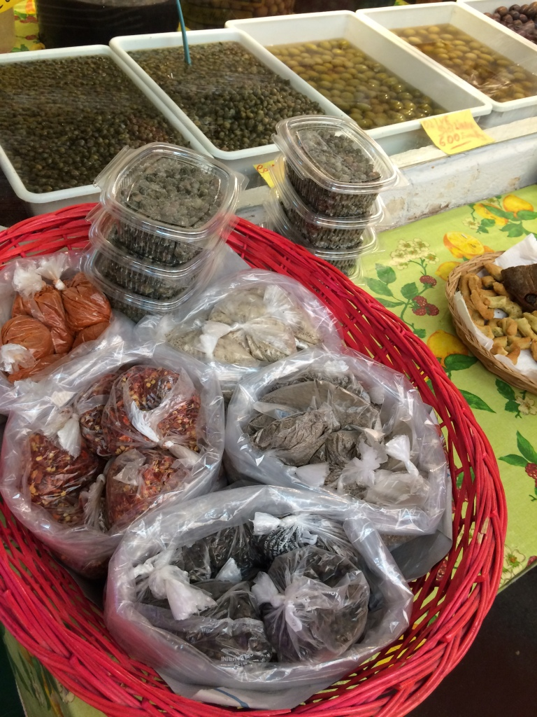 various seasonings and containers of capers